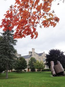 Hawkins hall from SUNY Plattsburgh campus during the fall with changing leaves