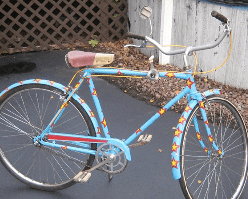 blue three speed bicycle with red and yellow stars on the frame and fenders, painted and assembled by kimberly cummins