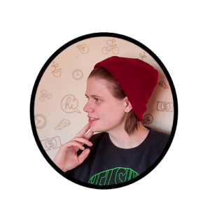 circular image inside a profile image of kimberly cummins wearing a black shirt and red hat