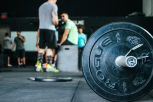 Crossfit gym with weights on ground and people working out in plattsburgh, ny