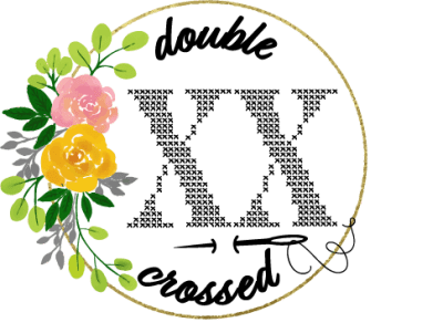 logo design of a cross stitch x's and cursive saying double crossed